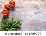 tomatoes spices and basil on... | Shutterstock . vector #695989774