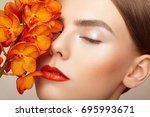 portrait of beautiful young... | Shutterstock . vector #695993671