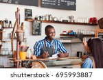 smiling young african barista... | Shutterstock . vector #695993887