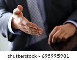 man in suit and tie give hand... | Shutterstock . vector #695995981