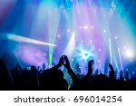 many people enjoying concert ... | Shutterstock . vector #696014254