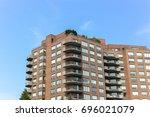 modern condo buildings in... | Shutterstock . vector #696021079