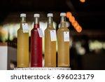 kombucha tea bottle with... | Shutterstock . vector #696023179