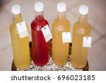 kombucha tea bottle with... | Shutterstock . vector #696023185