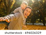 parents play with child in... | Shutterstock . vector #696026329
