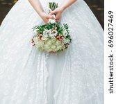 bride in wedding dress with... | Shutterstock . vector #696027469