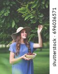 beautiful girl out picking... | Shutterstock . vector #696036571