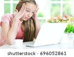 teen girl using laptop   Shutterstock . vector #696052861