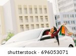 happy asian tourist woman raise ... | Shutterstock . vector #696053071