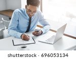 concentrated young afro...   Shutterstock . vector #696053134