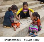 children play game with chalk... | Shutterstock . vector #696057589