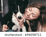 young pretty woman hugging and... | Shutterstock . vector #696058711