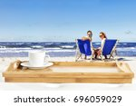 summer time and wooden space  | Shutterstock . vector #696059029