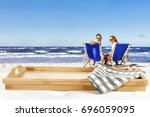 summer time and wooden space  | Shutterstock . vector #696059095