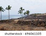 shoreline and rock walls of... | Shutterstock . vector #696061105