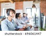 call center worker accompanied... | Shutterstock . vector #696061447