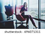 woman employee in purple suit... | Shutterstock . vector #696071311