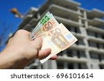 man holding euro notes in front ... | Shutterstock . vector #696101614