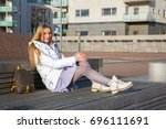 Girl sitting at the cute district of the Western Harbour in Malm