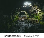 entrance to magnificent lava... | Shutterstock . vector #696124744