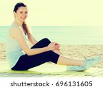 young smiling woman posing... | Shutterstock . vector #696131605