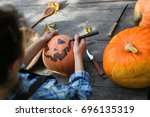 carve pumpkins for halloween | Shutterstock . vector #696135319