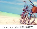 view on bikes on paradies beach ... | Shutterstock . vector #696140275