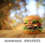 tasty burger with bacon on... | Shutterstock . vector #696143551