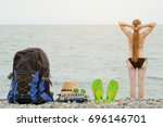 backpack  hat and flip flops on ... | Shutterstock . vector #696146701