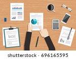 businessman at his desk... | Shutterstock .eps vector #696165595