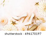 female shoes and golden... | Shutterstock . vector #696170197