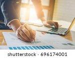 consult financial concept.... | Shutterstock . vector #696174001