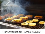 burgers on the grill | Shutterstock . vector #696176689