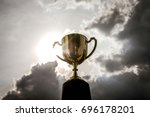 golden trophy with dark sky... | Shutterstock . vector #696178201