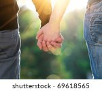 Stock photo concept shoot of friendship and love of man and woman two hands over sun ray and nature 69618565