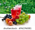 two glasses of juice and a pile ... | Shutterstock . vector #696196081