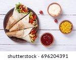 mexican burrito with chicken  ... | Shutterstock . vector #696204391