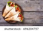 mexican burrito with chicken  ... | Shutterstock . vector #696204757