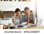 serious man and female looking... | Shutterstock . vector #696230809
