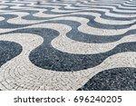 tile brick floor in lisbon town ... | Shutterstock . vector #696240205