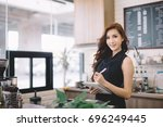 successful small business owner ... | Shutterstock . vector #696249445