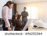 team of asian engineers... | Shutterstock . vector #696252364