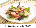 Closeup of salad with grilled apples, baby spinach, pecans, spring mix and chedar cheese served for healthy lunch - stock photo