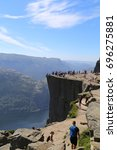 Small photo of Preikestolen, Norway - July, 01, 2017: tourists admire and relaxing on the summit of Preikestolen