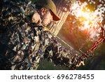 modern bow hunter   Shutterstock . vector #696278455
