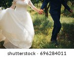 the bride and groom run through ... | Shutterstock . vector #696284011