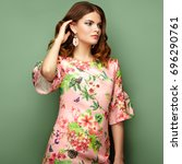 brunette young woman in floral... | Shutterstock . vector #696290761