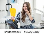 beautiful young female patient... | Shutterstock . vector #696292309