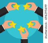 hands holding rating star....   Shutterstock .eps vector #696295699