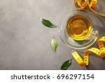 cup of tea and measuring tape... | Shutterstock . vector #696297154